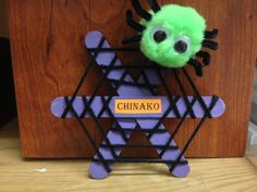 Spider web: Poof ball, pipe cleaner (for legs), yarn, fake eyes and Popsicle sticks (3 per door dec).