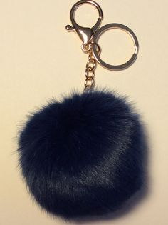Hello, Animal Lovers!     Decorate your bag or purse with this beautiful accessory!     -This pom pom keychain was made with 100% faux fur    -The feel of the pom pom is softer than many other pom poms on the market    -The pom pom's synthetic fibers are made of Kanecaron, which is modified acrylic (modacrylic) fiber    -The pom pom feels like fur but you can rest assured that it is synthetic so no cutie pies were harmed in the production of this pom pom    -The Navy Blue pom pom measures…
