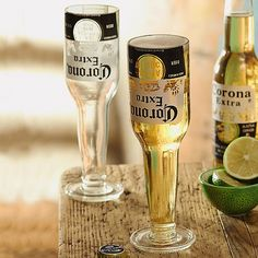 £12.99 Pair of Corona Glasses  Pair of glasses made from recycled Corona bottles. Corona is produced by Cerveceria Modelo in Mexico and is one of the top selling beers worldwide.