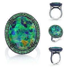 This platinum ring features a 13.46 carat Australian black opal surrounded by a halo of tsavorite garnets and accented with sapphires and diamonds. Omiprive