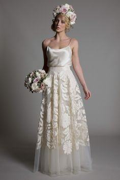 2 piece wedding dress: satin top and embellished tulle skirt. Love the floral pattern.  Kate Halfpenny