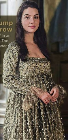 Mary in cream embroidered dress with lace.