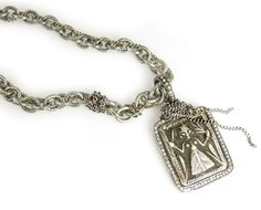 Kali, the goddess of empowerment. Rare ancient medallion surrounded in diamonds and oxidized wrapped chain. nanfusco.com