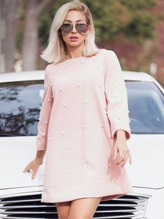 3/4 Sleeve Dresses. Short Tunic Decorated with Pearls, Beaded, Zipper. Designed with Round Neck. Natural Waist. Perfect choice for Casual wear. Plain design. Trend of Spring-2018, Fall-2018. Designed in Pink. Fabric has no stretch.
