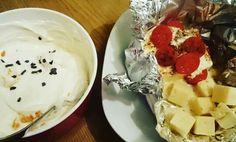 Ofen Feta mit Tomaten, dazu ein paar Käsewürfel und eine Quarkspeise mit Mandarinen