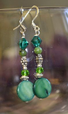 Green and Silver Dangle earrings by STailCollective on Etsy, $15.00 Website: Scissortailcollective.squarespace.com Or find us on Etsy Shop Name: Stail Collective