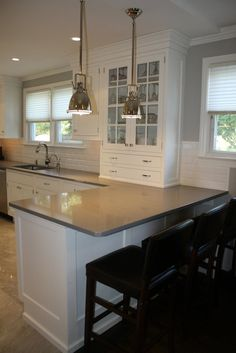kitchen designs with peninsula bar | cabinetry, white kitchen, gray countertops, bar seating, kitchen bar ...
