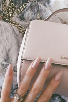 Kylie Jenner matches her nude nails to her Givenchy handbag, well, why not?