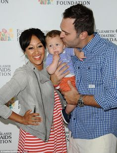 Long wait: On Thursday Tamera Mowry-Housley revealed that she did not loose her virginity until she was 29-years-old, to now husband Adam Housley seen here last month with son Aden..Awww LOVE HER <3