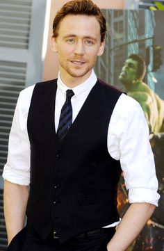 Tom Hiddleston--- Haha, ironic how Hulk is I the background!