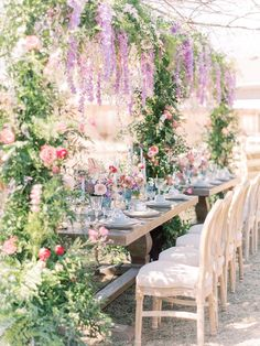 This Bridgerton inspired baby shower kept us on our toes with every frame from the rose shaped napkins to the floral canopy of wisteria hanging over the dinner table!