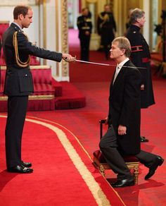 Prince William gives Headteacher Sir Kenneth Gibson a knighthood during his first investiture procedure