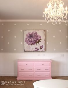 Polka dot decals, glam crystal chandelier, pink dresser, floral art, and Lottie Dot Decals from Land of Nod. | Nagwa Seif Interior Design