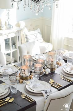 silver-and-gold-world-market-holiday-christmas-tablescape-ideas-with-snowflakes-and-hurricanes-with-candles-4-of-18