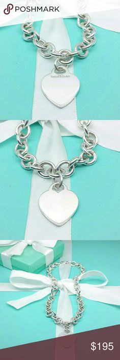 Tiffany & Co. Heart Tag Necklace Sterling Silver Treat youself to this gorgeous, 100% authentic Tiffany & Co. Heart Tag Necklace in 925 sterling silver.  This necklace is in freshly polished, ready-to-wear condition and includes original Tiffany box and pouch with white ribbon.  Perfect gift for an anniversary, birthday, holiday, or ANY occasion in which you care to make a lasting impression. Tiffany & Co. Jewelry Necklaces