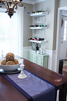 DIY bar area: ikea glass holders attached to Pottery Barn wine racks