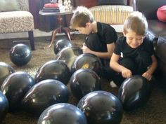 "Games - black balloon ""bombs"", - kids have to pop until they find complete spy clue"