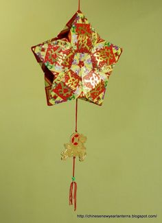 Chinese New Year Lanterns 红包灯笼手工制作 - Star-shaped lantern made from lucky envelopes.