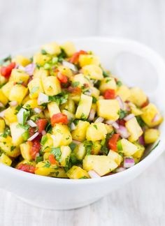 Sweet and Spicy Pineapple Salsa is your answer to summer snacking. It's perfect with chips or your favorite grilled meat while being kind to your waistline! #shop