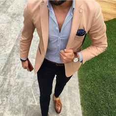 Consider pairing a tan blazer jacket with black chino pants to achieve a dressy but not too dressy look. Show your sartorial prowess with a pair of brown leather tassel loafers.   Shop this look on Lookastic: https://lookastic.com/men/looks/blazer-dress-shirt-chinos/24055   — White and Navy Polka Dot Dress Shirt  — Navy Paisley Pocket Square  — Black Sunglasses  — Tan Blazer  — Dark Brown Leather Watch  — Dark Brown Leather Belt  — Dark Brown Bracelet  — Black Chinos  — Brown Leather Tassel…