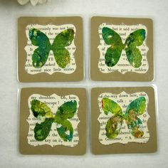 Pack of four handmade Green Butterfly Ink Art Coasters. I have created the Butterflies with alcohol inks, metal leaf and glitter. Handpainted on heat resistant laminate. Layered with card and a scrap from a vintage book then completely heat laminated. Green Butterfly, Ink Art, Handmade Crafts, Green Colors, Coasters, Scrap, Hand Painted, Alcohol Inks, Create