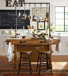 An antique carpenter's workbench was the inspiration for this beautiful kitchen island. #potterybarn