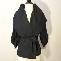 """Just In  Amazing Black Statement Jacket Who said black has to be basic? This jacket is simply amazing. Stylish collar, double breasted snap closure, knit insert on side to enhance fit, amazing pleated details on sleeve. 100% poly Hand wash 40"""" bust  36"""" waist 21"""" overall length SHOW OFF YOUR UNIQUE STYLE!!! Jackets & Coats Blazers"""
