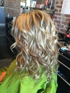 White blonde highlights with chocolate brown  chunky lowlights  long curls. #aloxxi #kreationsbykatie