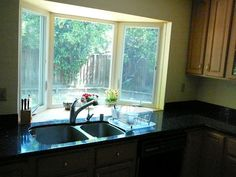 bay window in kitchen have decorative spaces while still allowing sufficient light