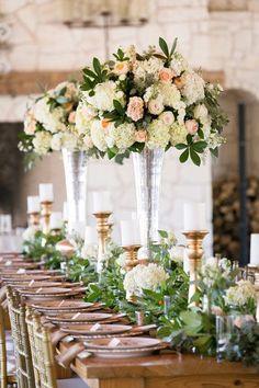Tracy Autem & Lightly Photography; Stunning garden-inspired indoor white and pink flower wedding reception centerpiece