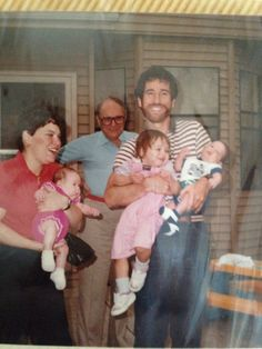 Emily, me, and Rachel being held by Margie and Marc with Harold as the photo bomb before it was cool!
