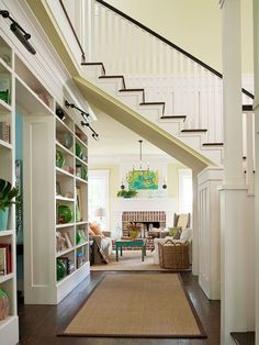 A built-in bookcase under the stairs adds an unexpected touch of character to this cheerful home. See more creative ways to store books: http://www.bhg.com/decorating/storage/organization-basics/creative-ways-to-store-books/?socsrc=bhgpin022613understairbookcase=5