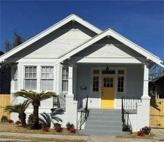 1634 General Ogden St, New Orleans, LA 70118  simply cute. gray house + yellow door