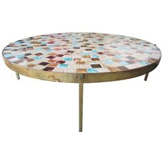 1956  A rare brass coffee table with inset tile top. Designed by Margot Stewart for Stewart Studio as shown in furniture forum 1956.