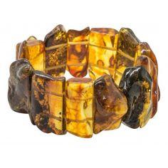 Gros bracelet en ambre naturel multicolore, taille ajustable. Le bracelet est composé d'ambre couleur miel, vert, et cognac. Circonférence: 18 cm Longueur des pierres: 2 - 3 cm