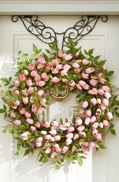 Put a fresh new face on your home with the look of professionally designed foliage that never needs watering, with this Tulip Wreath.   Love, Grandin Road