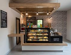 Sütizz Confectionery in Budapest is part of Cafe counter This week's project is Sütizz Confectionery which was opened recently in the district of Budapest It was a pleasure to work for a c - Coffee Bar Design, Coffee Shop Interior Design, Restaurant Interior Design, Bakery Shop Interior, Small Restaurant Design, Small Cafe Design, Modern Restaurant, Coffee Shop Counter, Cafe Counter