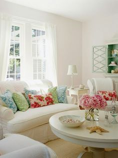 Simple white contrasted with pops of mint, pink, and light blue. The color scheme is repeated in different patterns down to the candy dish.