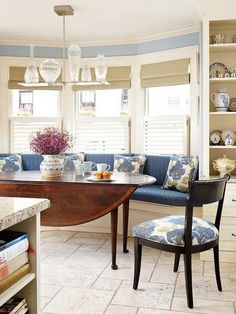 Bay window seating with small breakfast table.  love the concept but not so much the colors.  The light is confusing as well, but interesting.