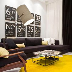 Modern Interior Design With Black Comfy Sofa And Spotlight Floor Lamp Also Yellow Rug Upholstered Armchair Of Trinity Bellwoods Town Homes