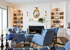 Waterfront House Remodel, by Traditional Home...I love all the built-ins, especially the bookcase/cabinets flanking the fireplace!  And, in a waterfront home?  Blue and white is perfect.