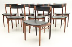 Set of 8 side chairs in rosewood. Designed by Henry Rosengren Hansen and manufactured in the mid 1950s by Brande Møbelindustri, Denmark. www.reModern.dk