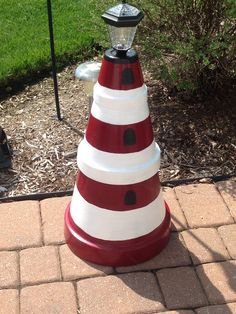Lighthouse made of terra cotta pots and a solar light. Lighthouse made of terra cotta pots and a sol Solar Lighthouse, Clay Pot Lighthouse, Lighthouse Decor, Clay Pot Projects, Clay Pot Crafts, Clay Flower Pots, Flower Pot Crafts, Solar Licht, Flower Pot People