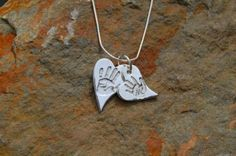 Double Stacked Hand/Footprint Silver heart pendant  by silverhaven