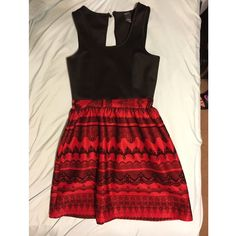 Black and Red Casual Party Dress In good condition. Only worn once. The thread holding the button in the back is loose and could break if tugged on hard enough. Delicate looking black lace lining the red skirt part of dress. Made for someone with a smaller bust. Rue 21 Dresses