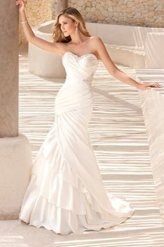 Make a lasting impression from every angle in this Dolce Satin fit and flare asymmetrical ruched bodice designer gown. The strapless neckline and hip detail are adorned with Swarovski Crystals that dazzle and delight. Dream Wedding Dresses, Bridal Dresses, Wedding Gowns, Lace Wedding, Wedding Venues, Ruched Wedding Dress, Wedding White, White Bridal, Crystal Wedding