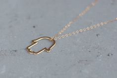 Hamsa Necklace For Women , Gold Hamsa Pendant , Hamsa Charm , Hamsa Jewelry , Minimalist Hamsa , Hamsa Hand , Jewish Necklace , Gift Under 50  Delicate, minimalist and simple  This delicate Hamsa necklace will quickly make it your everyday piece. A perfect layering necklace or beautiful on its own. The pendant is made of brass plated with high quality gold, hanging on gold filled chain. Gold filled is a wonderful alternative for those who love gold but want something more affordable…