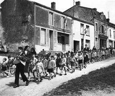 Robert Doisneau  //  The Children's Parade, circa, 1945.