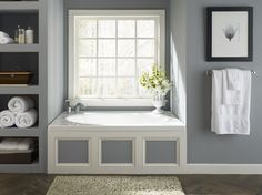 Sunny Bathtub Nook with Storage Alcoves traditional bathroom