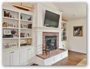 shelving next to fireplace - like the additional counter space above the bottom cabinets